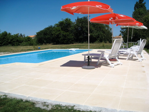 Large swimming pool terrace at gites in France