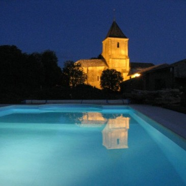 The church from the pool at night