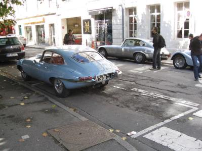 E-Types adorn the street, even if badly parked!